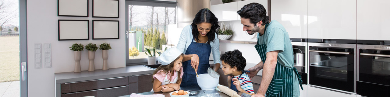 family cooking in modern kitchen