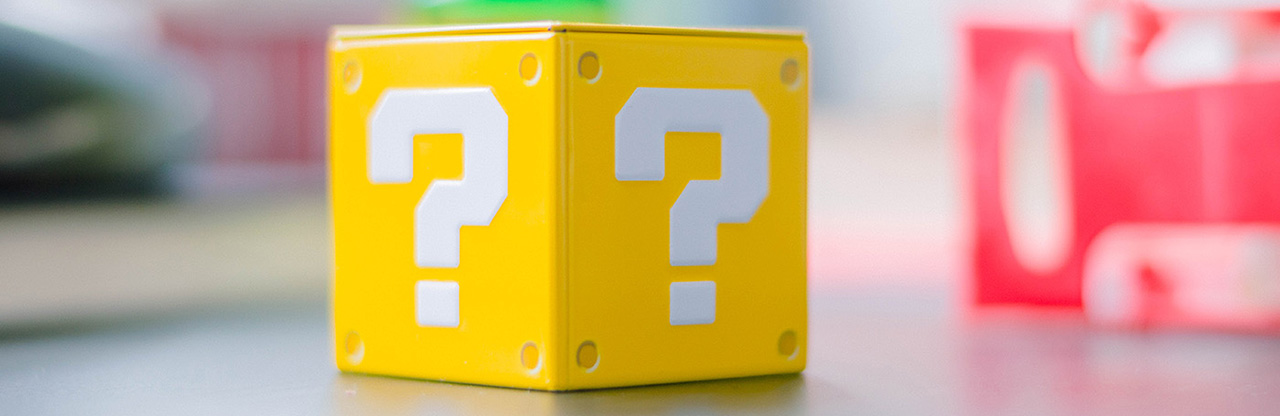 question mark on yellow toy block